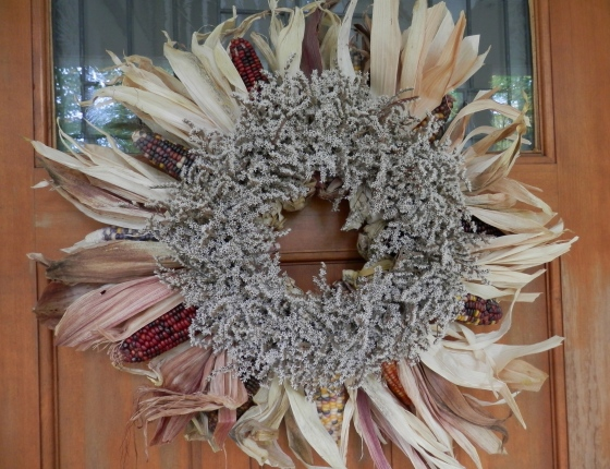 front door ~ indian corn wreath topped by status wreath.