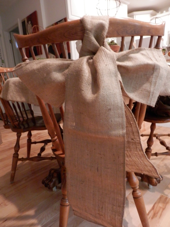 burlap bows on the dinning chairs