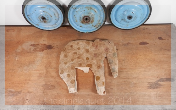 elephant pull toy with blue wheels